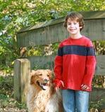 Boy Walking the Dog Stock Images