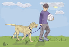 Boy walking with dog Royalty Free Stock Photography