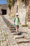 The boy is walking down stone steps Stock Photo