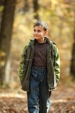 Boy walking through forest Royalty Free Stock Photography