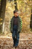 Boy walking through forest Royalty Free Stock Photos