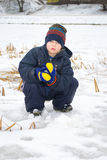 Boy walking. On a frozen pond stock image
