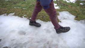 Boy walking on frozen road. The boy is in the winter on frozen road. Shooting with Steadicam 4K stock footage