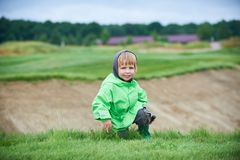Boy walking the golf course. Little boy walking the green golf course Stock Image
