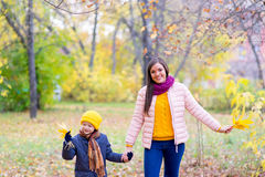 Boy walking with his mother in autumn park Stock Image