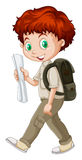 Boy walking with a map in hand Royalty Free Stock Photography