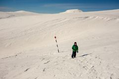 Boy walking on a marked path on the mountain. Little boy walking on a marked path on the mountain, during winter season royalty free stock photo