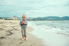 Boy walking near the sea royalty free stock photography
