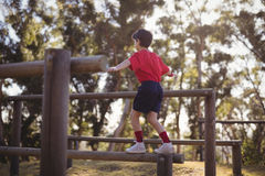 Boy walking on obstacle during obstacle course royalty free stock photos