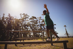 Boy walking on obstacle during obstacle course stock photos