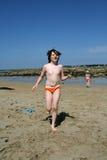 Boy Walking On A Beach Royalty Free Stock Image
