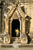 Boy walking out the door of Maha Aungmye Bonzan Monastery at Inw Royalty Free Stock Photography