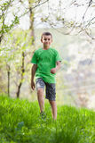 Boy walking outdoor Stock Image