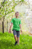 Boy walking outdoor Stock Photos