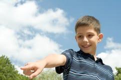 Boy walking outdoors Royalty Free Stock Image