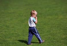 Boy walking in the park Stock Photos