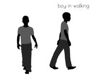 Boy in walking pose on white background Royalty Free Stock Image