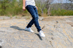 Boy walking on the rocky land. Royalty Free Stock Photography
