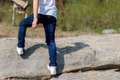Boy walking on the rocky land. Royalty Free Stock Images