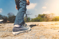 Boy walking on the rocky land. Royalty Free Stock Photos