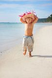 Boy walking on sand beach Royalty Free Stock Photos