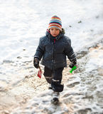 Boy walking in snow Royalty Free Stock Photo
