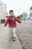 Boy walking on stone stripes Royalty Free Stock Images