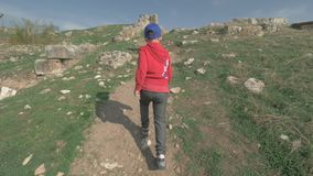 Boy walking to the ancient ruins in Pamukkale, Turkey stock video footage