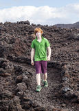 Boy walking in volcanic area Royalty Free Stock Image