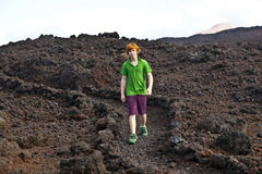 Boy walking in volcanic area Royalty Free Stock Photography