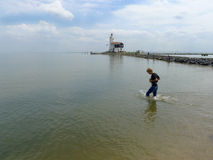 Boy walking in water Royalty Free Stock Photos