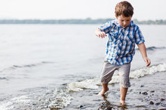 Boy walking in water Royalty Free Stock Images