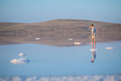 A boy walks along the shore of the lake. A Salt lake shore. A Salt Lake. A boy walks along the shore of the lake. A Salt lake shore. A Salt Lake royalty free stock images