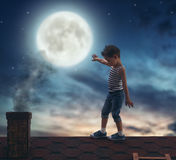 Boy walks on the roof Royalty Free Stock Photography
