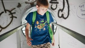 The boy walks under the bridge and climbs into a metal hole. Cool metal corridor. Atmospheric shots stock video footage