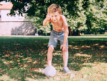 Boy want to kick the ball Royalty Free Stock Images