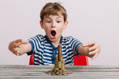 Boy wanting to take stack of money Royalty Free Stock Image