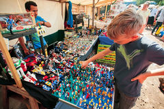 Boy wants to buy the small toy figures of Lego designer Stock Photography