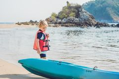 The boy wants to ride a kayak stock photos
