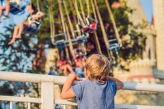 The boy wants to ride on the merry-go-round royalty free stock image