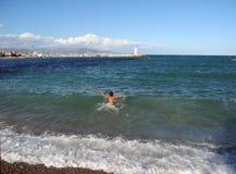 The boy wants to swim. stock photos