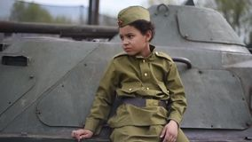 Boy on the war. Child schoolboy on a tank. The boy in the form of a soldier during the Second world war of 1941-1945. stock video