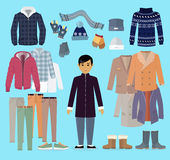 Boy in Warm Clothes Stands in Centre on Blue. Stock Image