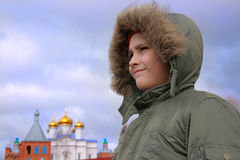 The boy in a warm hood. On a background of gold domes Stock Image