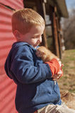 Boy with warm kitten Royalty Free Stock Photos
