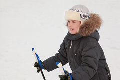 Boy in warm sport dress skiing at forest Royalty Free Stock Photo