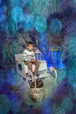 Boy in a warm sweater sitting on a sleigh Stock Images