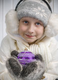 Boy in warm winter clothes holding a Christmas Stock Photos
