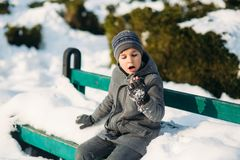 A boy warms his hands from the cold in winter.  Stock Photos