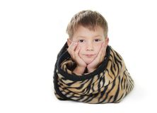 Boy warped up with counterpane Royalty Free Stock Photography
